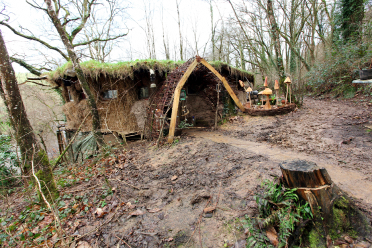The hut is made out of tree trunks, straw and mud (SWNS)