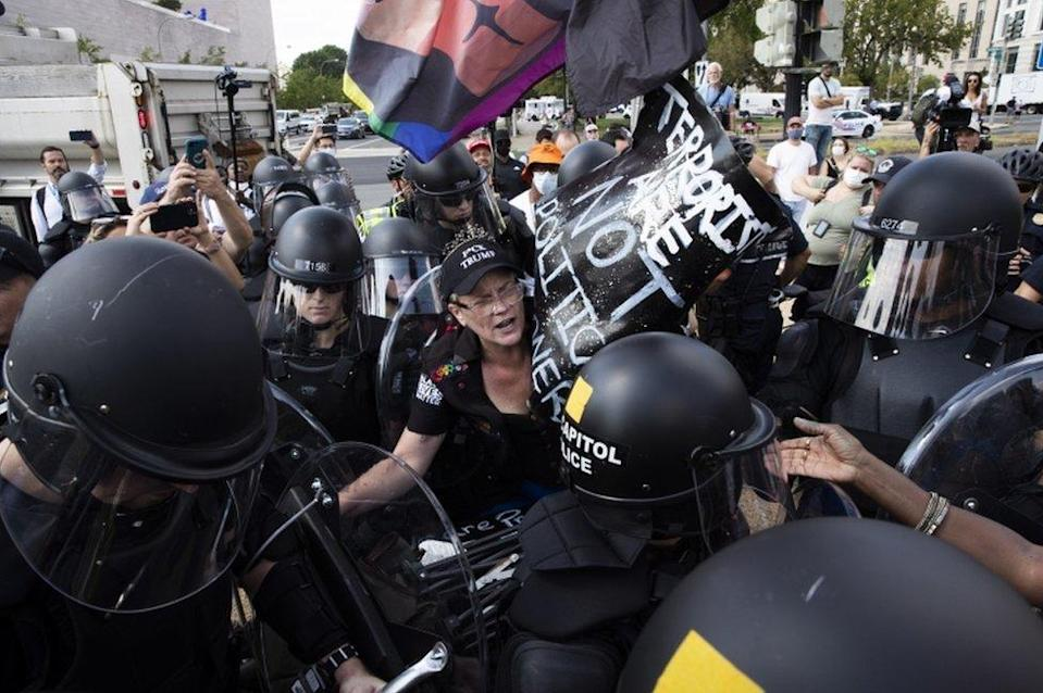 US Capitol Police in riot gear surround a counter-protester