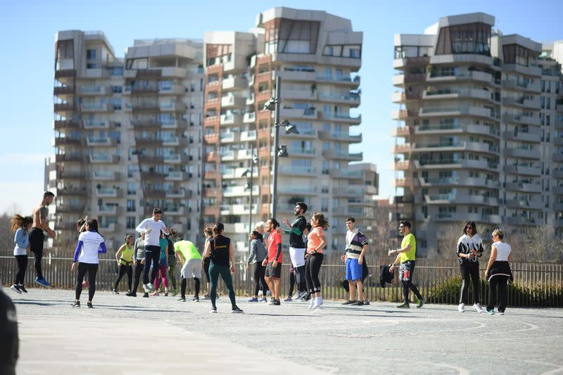 People train in a local park as gyms are closed as part of measures to try and contain a coronavirus outbreak, in Milan