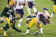 Chicago Bears' David Montgomery is stopped during the first half of an NFL football game against the Green Bay Packers Sunday, Nov. 29, 2020, in Green Bay, Wis. (AP Photo/Matt Ludtke)