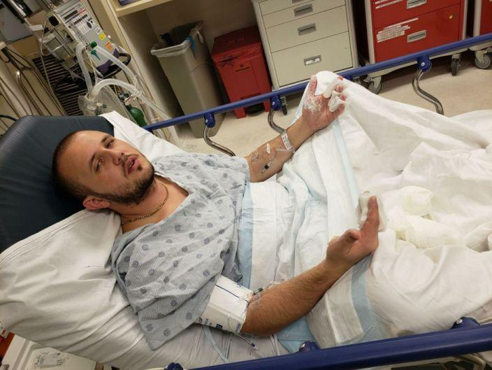 Mr Piluyev is pictured in hospital. Source: USA Today