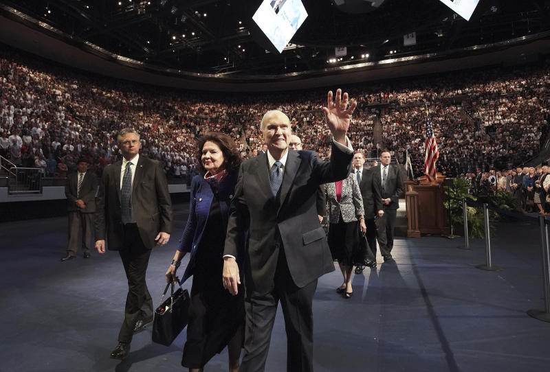 Russell M. Nelson, president of The Church of Jesus Christ of Latter-day Saints,  and his wife Sister Wendy Nelson wave to students after a devotional at Brigham Young University in Provo, Utah, Tuesday, Sept. 17, 2019. Nelson reaffirmed Tuesday the religion's opposition to gay marriage by explaining that he and fellow leaders have a duty to teach God's law that says marriage is restricted to man-woman unions.  (Jeffrey D. Allred/The Deseret News via AP)