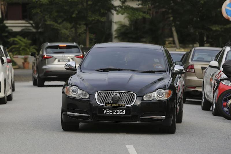 Datuk Ibrahim Mat Zain's black Jaguar luxury sedan is seen with the number plate VBE 2364, that also had another plate stating 'Raja Bomoh VVIP'.