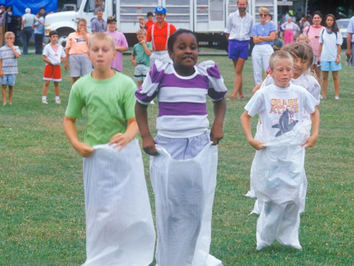 Children in a potato sack race, in East Shore, Maryland, July 4, 1991.