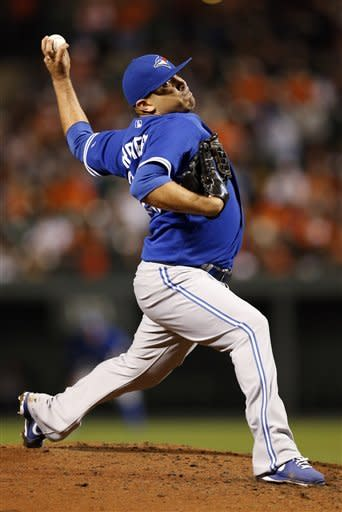 Toronto Blue Jays starting pitcher Ricky Romero throws to the Baltimore Orioles in the second inning of the second baseball game of a doubleheader in Baltimore, Monday, Sept. 24, 2012. (AP Photo/Patrick Semansky)
