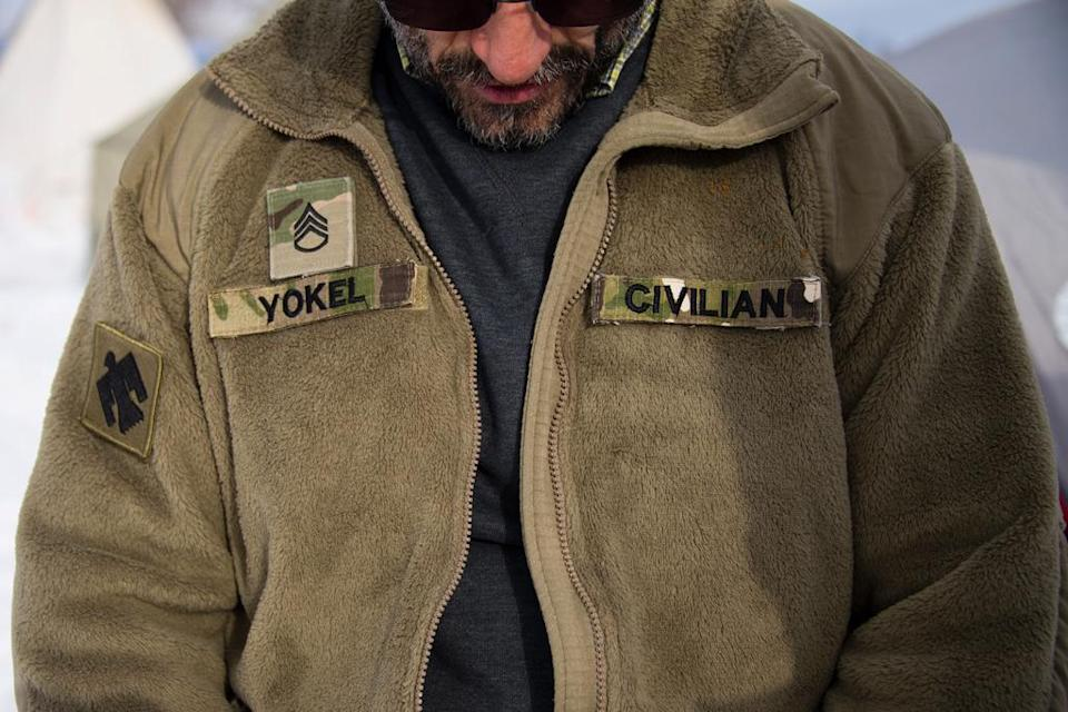 """A U.S. Army veteran who served in Afghanistan wearing the same """"cozy"""" fleece. (Photo: Jim Watson/AFP/Getty Images)"""