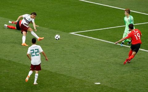 Javier Hernandez scores Mexico's second and his 50th goal for his country - Credit: AP Photo/Efrem Lukatsky