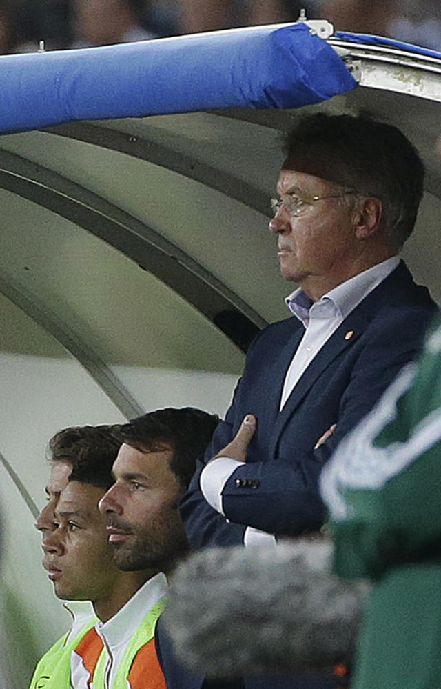 Netherlands coach Guus Hiddink, right, watches the game during a friendly soccer match between Italy and The Netherlands in Bari, Italy, Thursday, Sept. 4, 2014. (AP Photo/Gregorio Borgia)