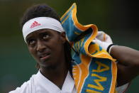 Sweden's Mikael Ymer uses a towel during the men's singles first round match against Jo-Wilfried Tsonga of France on day three of the Wimbledon Tennis Championships in London, Wednesday June 30, 2021. (AP Photo/Kirsty Wigglesworth)