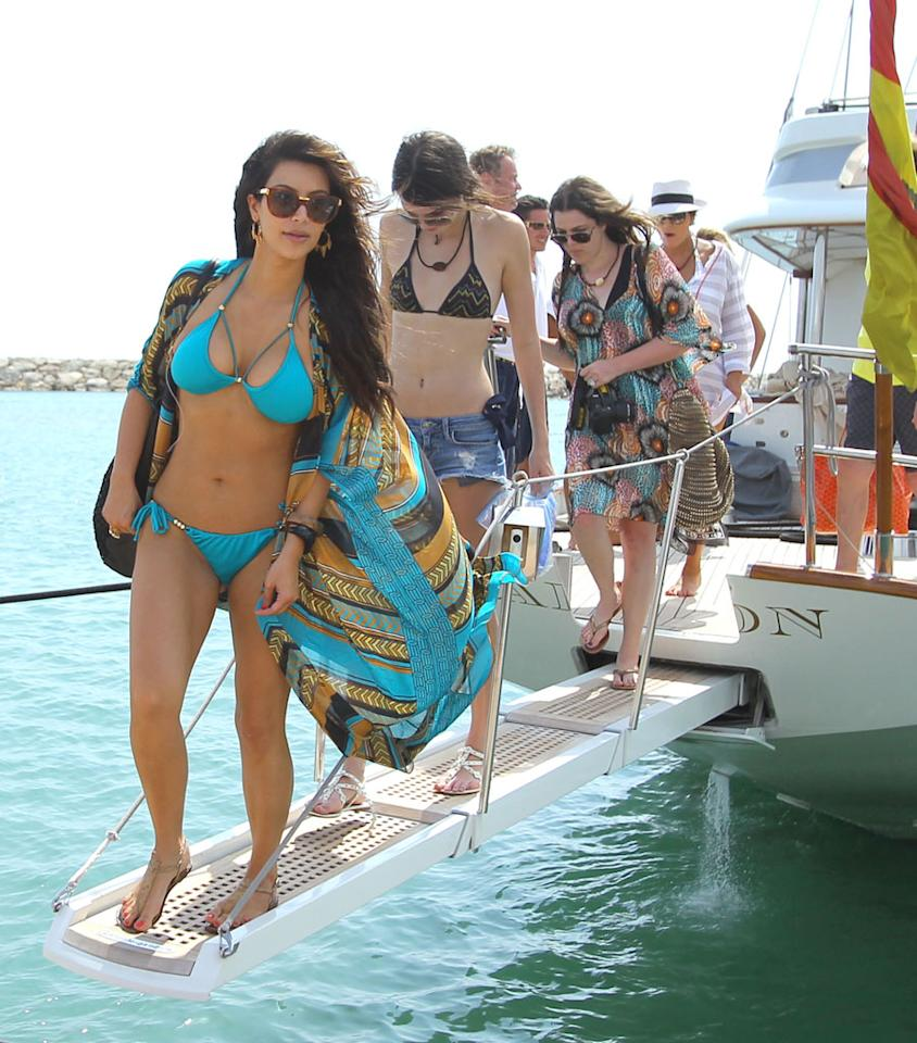 EXCLUSIVE: *PREMIUM RATES APPLY*STRICT WEB EMBARGO UNTIL 9PM GMT ON APRIL 10TH* Kim Kardashian leads her bikini family parade in the Dominican Republic as she got off of a sailboat. Kim even jumped off the boat with her sister Khloe watching her fall from the high point on the boat. Kim then stood next to her sister Kylie Jenner as she jumped off too. Kylie then was kayaking with Khloe and Rob Kardashian. Kris Jenner joined in the fun with her Penguin floaty.  Photos taken on March 29th, 2012.