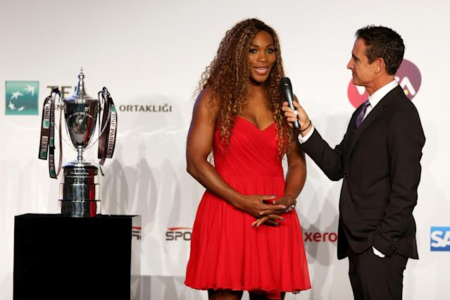 ISTANBUL, TURKEY - OCTOBER 20: Serena Williams of the United States is interviewed by master of ceremony Andrew Krasny during the draw ceremony for the WTA Championships at the Renaissance Polat Hotel on October 20, 2013 in Istanbul, Turkey. (Photo by Matthew Stockman/Getty Images)