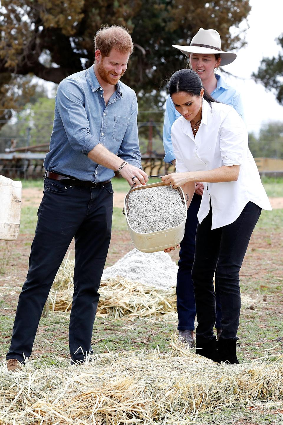 """<p>The 37-year-old had her hair tied back in a sleek ponytail, a style we don't normally see from the royal. Meghan's go-to hair looks are the duchess waves and her signature messy bun, but we did see her wear a ponytail for <a rel=""""nofollow"""" href=""""https://au.lifestyle.yahoo.com/royals-step-prince-louis-christening-204129042.html"""" data-ylk=""""slk:Prince Louis' christening;outcm:mb_qualified_link;_E:mb_qualified_link;ct:story;"""" class=""""link rapid-noclick-resp yahoo-link"""">Prince Louis' christening</a> back in July when she would <a rel=""""nofollow"""" href=""""https://au.lifestyle.yahoo.com/missy-higgins-accidentally-reveals-meghan-markle-pregnancy-detail-214842834.html"""" data-ylk=""""slk:already have been expecting.;outcm:mb_qualified_link;_E:mb_qualified_link;ct:story;"""" class=""""link rapid-noclick-resp yahoo-link"""">already have been expecting.</a><br>Photo: Getty </p>"""