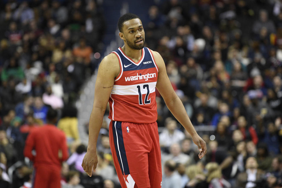 Washington Wizards forward Jabari Parker (12) stands on the court during the second half of an NBA basketball game against the Cleveland Cavaliers, Friday, Feb. 8, 2019, in Washington. The Wizards won 119-106. (AP Photo/Nick Wass)