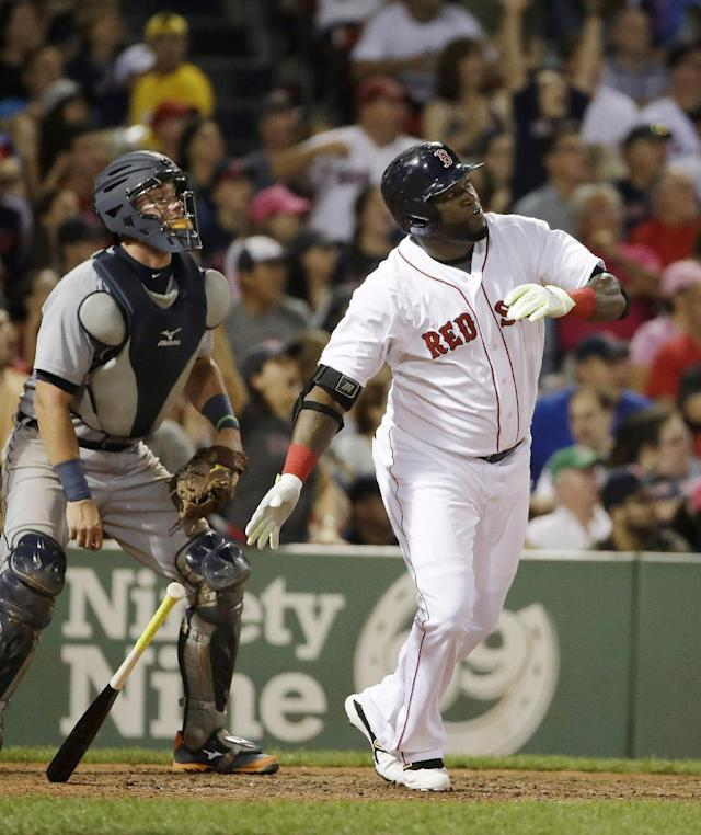 Boston Red Sox's David Ortiz, right, watches the flight of his three-run home run as Detroit Tigers catcher James McCann, left, looks on in the seventh inning of a baseball game Sunday, July 26, 2015, in Boston. It was Ortiz second three-run home run of the evening. The Red Sox won 11-1. (AP Photo/Steven Senne)