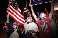 Trump supporters wave flags in front of the Clark County Election Department, Thursday, Nov. 5, 2020, in Las Vegas. (AP Photo/Jae C. Hong)