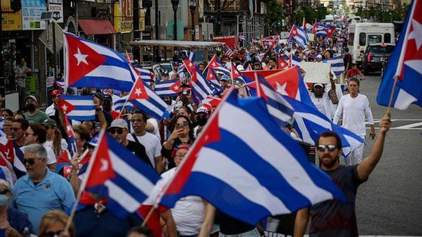 PHOTO: People wave Cuban flags as they march during a protest showing support for Cubans demonstrating against their government, in Union City, N.J, July 18, 2021. (Kena Betancur/AFP via Getty Images)
