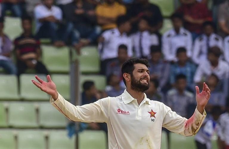 Zimbabwe cricketer Sikandar Raza, seen playing in the first Test cricket against Bangladesh last year, is opposed to the ICC ban on his country (AFP Photo/MUNIR UZ ZAMAN)