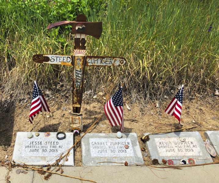 This June 3, 2019 photo shows memorial stones at the Wildland Firefighters Monument at the National Interagency Fire Center in Boise, Idaho, for wildland firefighters killed by a wildfire on June 30, 2013, near Yarnell, Ariz. Federal officials at the NIFC are bolstering mental health resources for wildland firefighters following an apparent increase in suicides. (AP Photo/Keith Ridler)