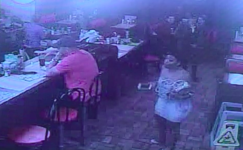 Astilltaken from a Waffle House surveillance video shows Chikesia Clemons approaching the restaurant's front counter.