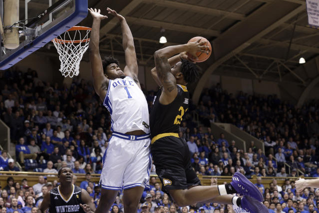 Duke center Vernon Carey Jr. (1) guards against Winthrop guard Jamal King during the first half of an NCAA college basketball game in Durham, N.C., Friday, Nov. 29, 2019. (AP Photo/Gerry Broome)