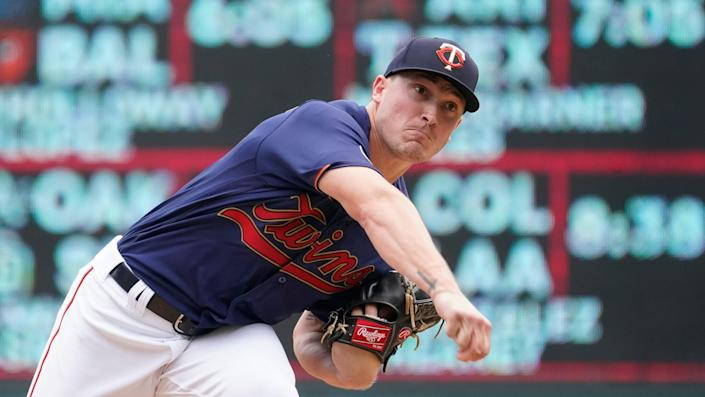 Minnesota Twins pitcher Beau Burrows throws in relief in the fourth inning of a baseball game against the Detroit Tigers, Wednesday, July 28, 2021, in Minneapolis.
