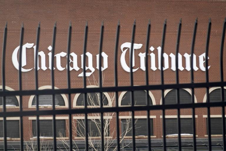 A sign hangs on the side of the one of the building that make up the Freedom Center, home to the Chicago Tribune, on February 17, 2021