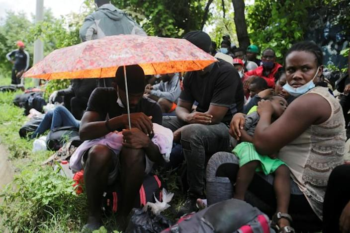 African, Cuban and Haitian migrants, which are stranded in Honduras after borders were closed due to the coronavirus disease (COVID-19) outbreak, rest while trekking northward in an attempt to reach the United States, in Choluteca