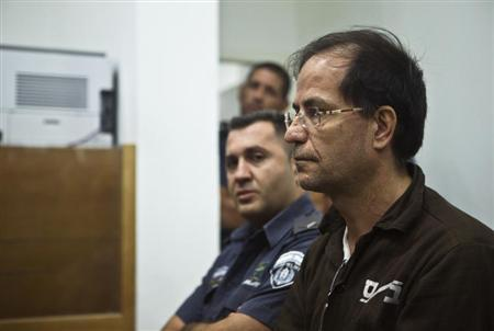 Iranian-Belgian citizen Ali Mansouri sits in a courtroom at court in Petah Tikva