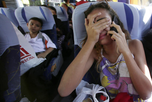 <p>A girl cries as she talks with her father who will remain in Ecuador as she return to Venezuelan in an airplane sent by Government of Venezuela. Quito, Ecuador, Wednesday, September 5, 2018. (AP Photo/Dolores Ochoa) </p>