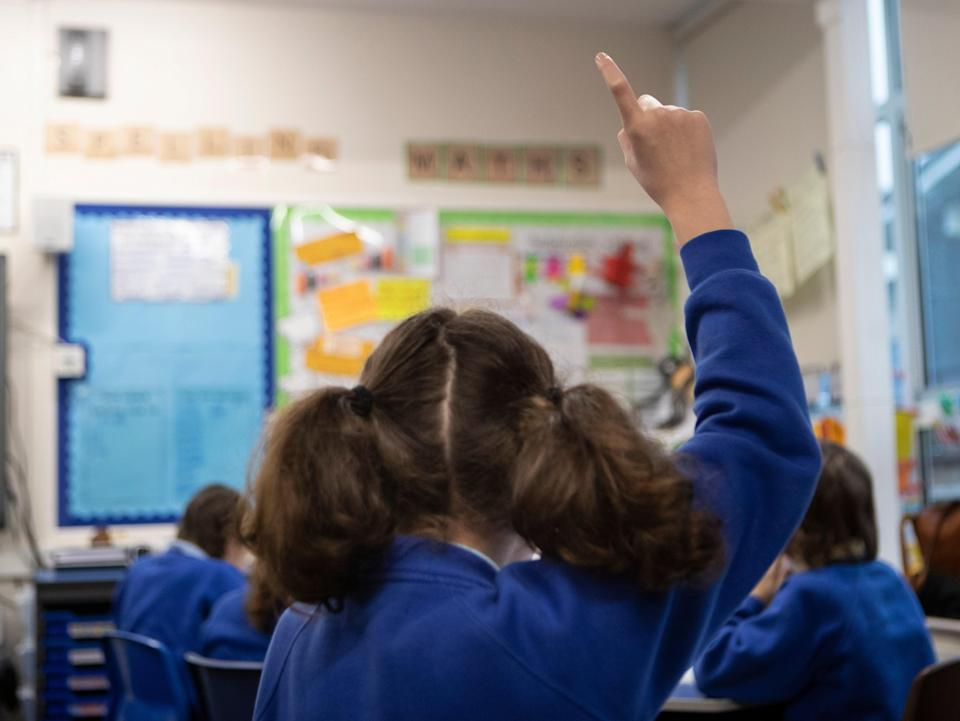 Currently all children who come into contact with a pupil who tests positive have to isolate at home  (PA Archive)