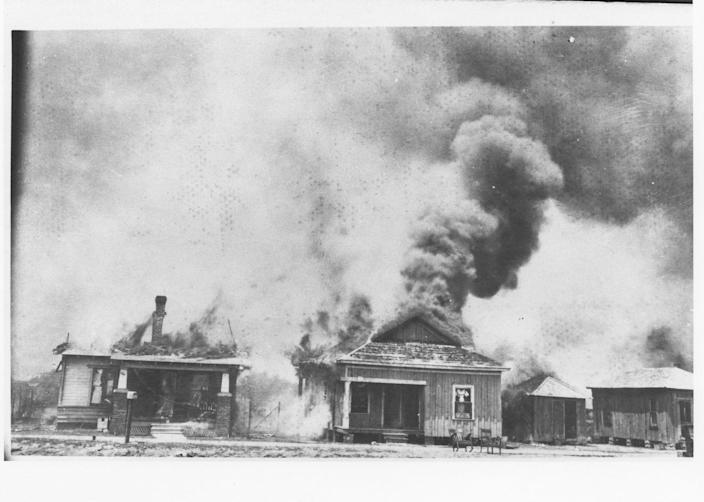 Houses on fire after the Tulsa massacre