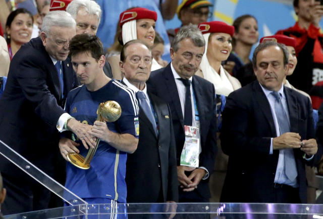 Argentina's Lionel Messi walks away after receiving the Golden Ball trophy following Germany's 1-0 victory over Argentina after the World Cup final soccer match between Germany and Argentina at the Maracana Stadium in Rio de Janeiro, Brazil, Sunday, July 13, 2014. (AP Photo/Felipe Dana)