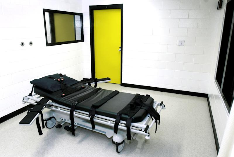"FILE - This Oct. 24, 2001 file photo shows the death chamber at the state prison in Jackson, Ga. Georgia has canceled all executions after federal drug agents seized its supply of a sedative used in lethal injections. The drug has been criticized by activists who oppose capital punishment and by death-row inmates, including one whose lawyers called the British exporter of the drug a ""fly-by-night supplier."" (AP Photo/Ric Feld, File)"