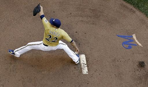 Milwaukee Brewers starting pitcher Matt Garza throws during the first inning of a baseball game against the Philadelphia Phillies Thursday, July 10, 2014, in Milwaukee. (AP Photo/Morry Gash)