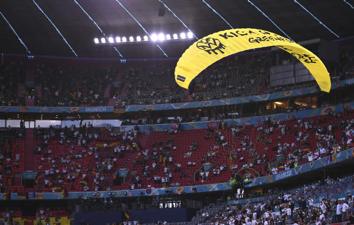 Paraglider soars through the air prior the start of the Euro 2020 soccer championship group F match between Germany and France at the Allianz Arena stadium in Munich, Tuesday, June 15, 2021. (Franck Fife/Pool via AP)