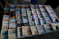 Newspapers are displayed in a newspaper stall in Yangon, Myanmar, Tuesday, Feb. 2, 2021. Hundreds of members of Myanmar's Parliament remained confined inside their government housing in the country's capital on Tuesday, a day after the military staged a coup and detained senior politicians including Nobel laureate and de facto leader Aung San Suu Kyi. (AP Photo/Thein Zaw)