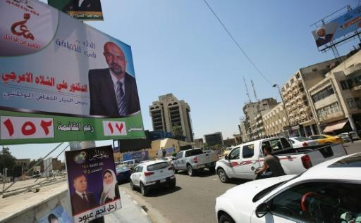 Electoral posters line the side of the road in central Baghdad ahead of Iraq's May 12 parliamentary elections
