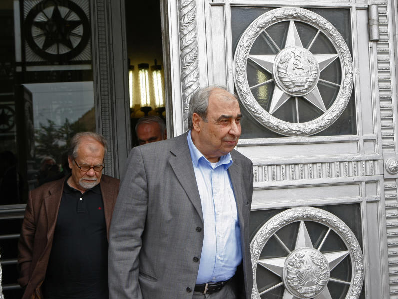 Michel Kilo, a Syrian opposition leader and writer, right, and other members of the delegation exit the building of Russia's Foreign Ministry after a meeting with the Russian Foreign Minister, in Moscow, Russia, Monday, July 9, 2012. A delegation of Syrian opposition figures led by Kilo visited Moscow for talks about the ongoing conflict in the Middle Eastern nation. (AP Photo/Alexander Zemlianichenko)