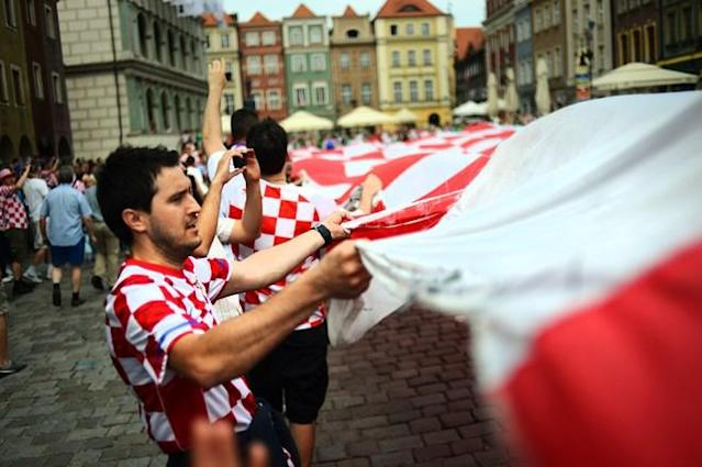 Croatian fans wave a giant Groatian flag at the central square in Poznan prior the match Croatia vs Ireland on June 10, 2012 during the Euro 2012 football championships. AFP PHOTO / DIMITAR DILKOFFDIMITAR DILKOFF/AFP/GettyImages