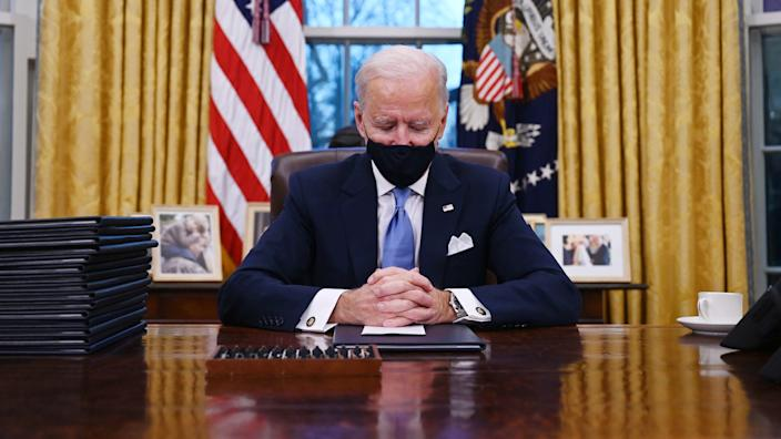US President Joe Biden sits in the Oval Office at the White House in Washington, DC, after being sworn in at the US Capitol on January 20, 2021. (Jim Watson/AFP via Getty Images)