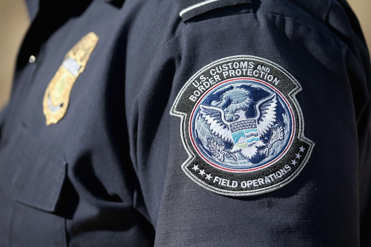 An officer from the U.S. Office of Field Operations stands near the U.S.-Mexico border on Feb. 26, 2013, in Nogales, Arizona. Some 15,000 people cross between Mexico and the U.S. each day in Nogales, Arizona's busiest border crossing. (Photo: John Moore via Getty Images)