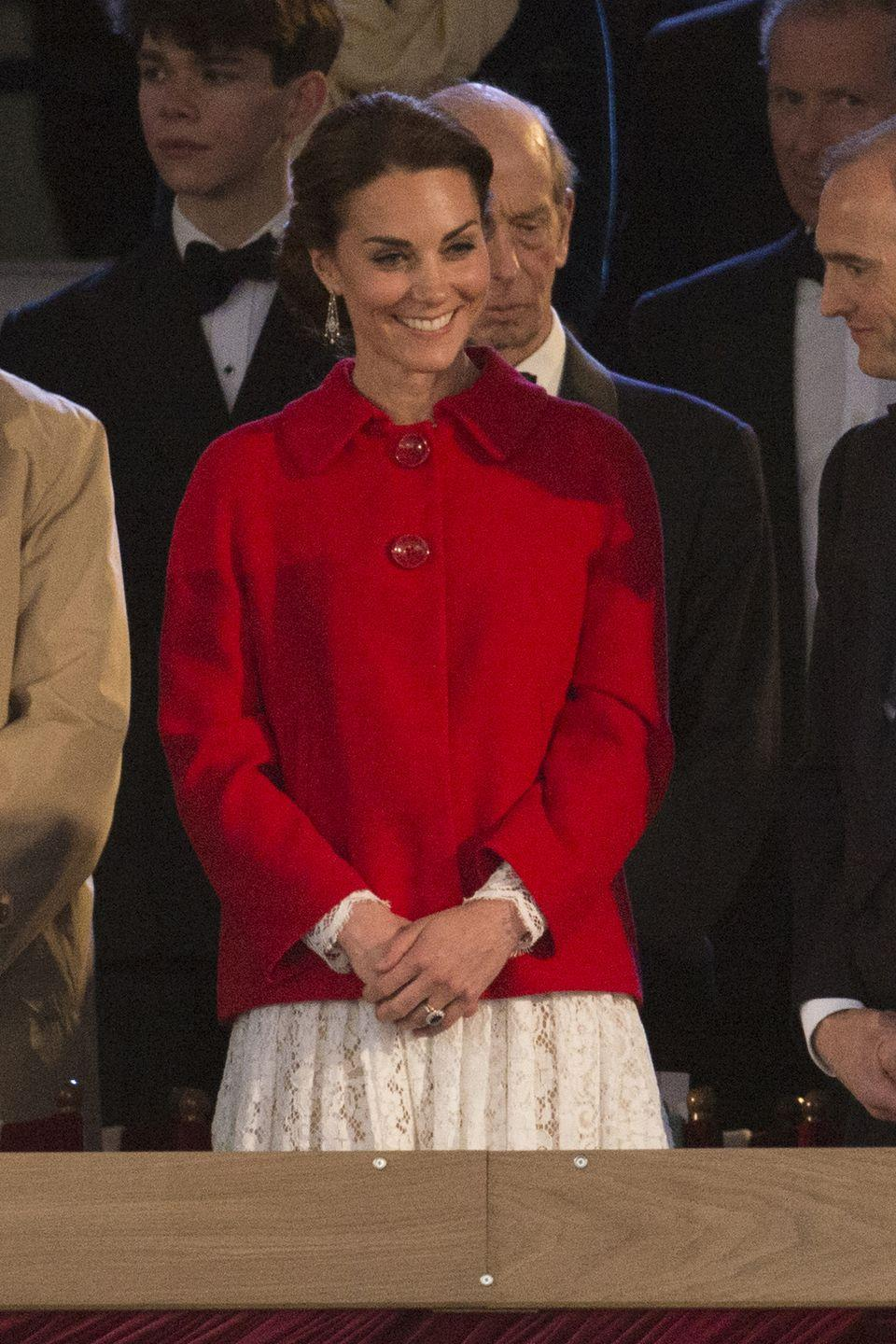 <p>Middleton was all smiles at Queen Elizabeth II's 90th birthday celebration. She mixed high and low pieces for the occasion, layering a crimson Zara coat over her lace Dolce & Gabbana dress. </p>