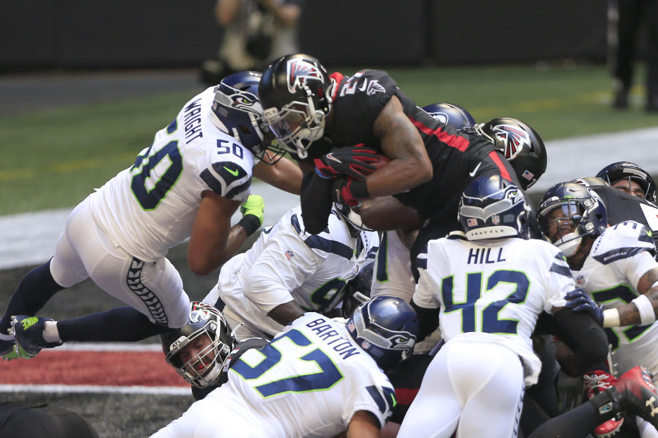 Todd Gurley of the Atlanta Falcons leaps over the goal line for a touchdown during the NFL Week 1 game between the Atlanta Falcons and the Seattle Seahawks on Sept. 13, 2020 at Mercedes-Benz Stadium in Atlanta, Georgia.