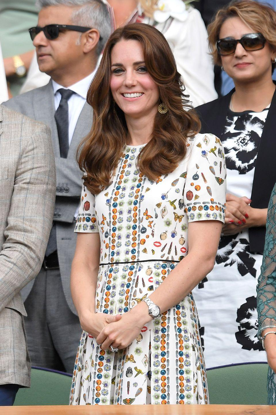 <p>The Duchess wore an Alexander McQueen printed midi dress, gold pendant earrings and a silver watch to the Wimbledon men's final. </p>