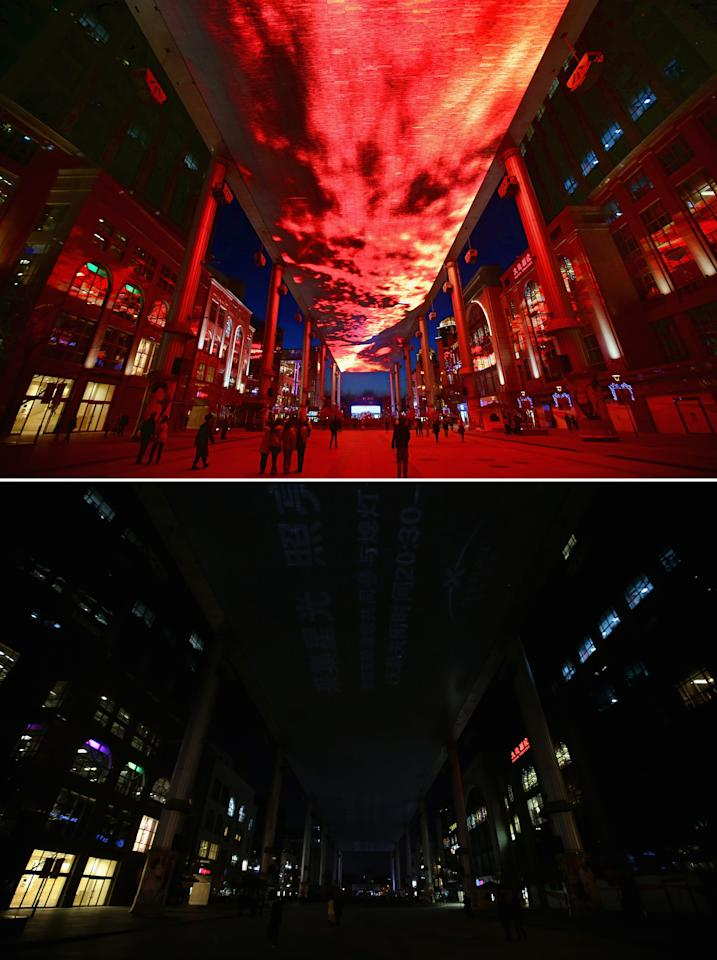 BEIJING, CHINA - MARCH 23: This composite photograph shows a huge LED sky screen before and during the Earth Hour 2013 power switch off at the Central Business District on March 23, 2013 in Beijing, China. Earth Hour, launched in 2007 in Australia by the World Wide Fund for Nature (WWF), a global conservation group, calls on people, organizations and cities to turn off their non-essential lights for one hour starting at 8:30 p.m. local time.  (Photo by Feng Li/Getty Images)