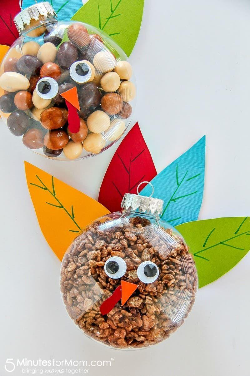 """<p>Make this fun craft with your kids and give them out as favors to your dinner guests (or keep for yourselves, we won't judge).</p><p><strong>Get the tutorial at <a href=""""https://www.5minutesformom.com/131060/turkey-treats-for-thanksgiving-easy-fall-craft/"""" rel=""""nofollow noopener"""" target=""""_blank"""" data-ylk=""""slk:5 Minutes for Mom"""" class=""""link rapid-noclick-resp"""">5 Minutes for Mom</a>.</strong></p><p><a class=""""link rapid-noclick-resp"""" href=""""https://www.amazon.com/Seekingtag-Clear-Fillable-Ornaments-Ball/dp/B00SXUQN3W/?tag=syn-yahoo-20&ascsubtag=%5Bartid%7C10050.g.28638625%5Bsrc%7Cyahoo-us"""" rel=""""nofollow noopener"""" target=""""_blank"""" data-ylk=""""slk:SHOP CLEAR ORNAMENTS"""">SHOP CLEAR ORNAMENTS</a></p>"""