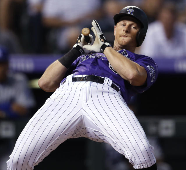 Colorado Rockies' DJ LeMahieu avoids a high, inside pitch from Los Angeles Dodgers starter Kenta Maeda during the fourth inning of a baseball game Friday, Aug. 10, 2018, in Denver. (AP Photo/David Zalubowski)