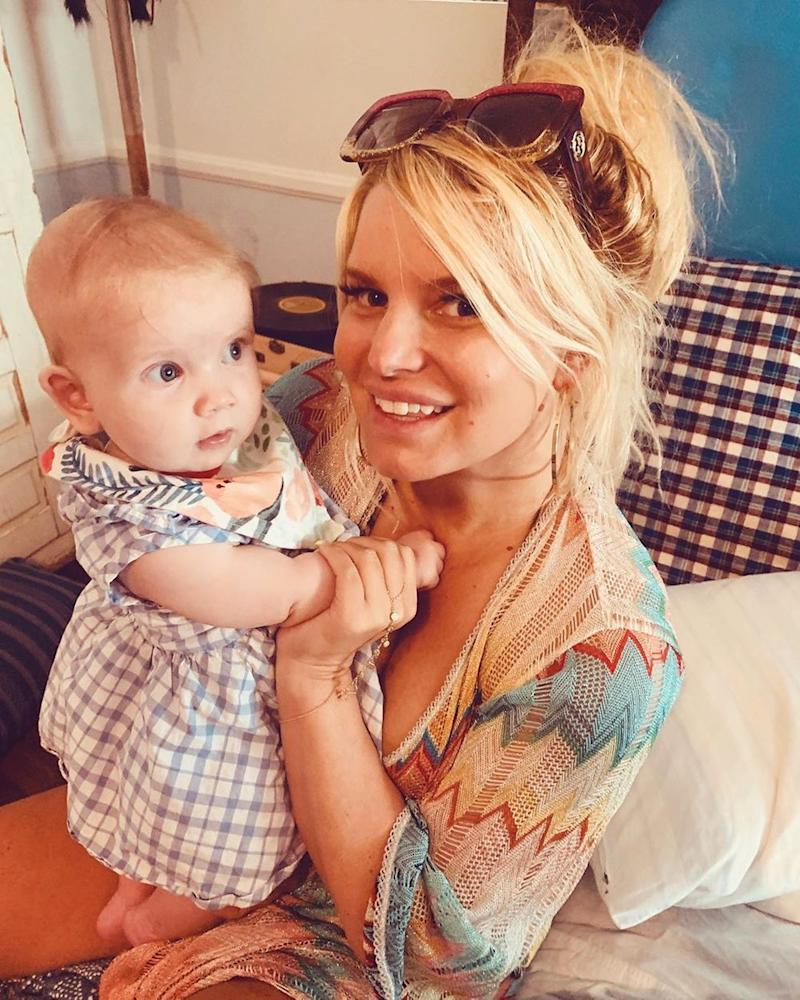 Jessica Simpson poses with her baby