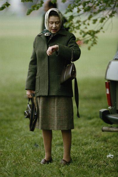 <p>Of course, Queen Elizabeth has to keep to a very busy schedule, but there's still something novel about seeing her check her watch. Here, she does just that in an off-duty look at a horse show in 1985. </p>