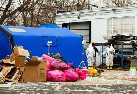 """FILE PHOTO: FBI agents search the premises during a December 2013 raid on Arthur Rathburn's warehouse in Detroit, Michigan, U.S. Agents said they found """"thousands"""" of body parts during the raid. REUTERS/Steve Neavling/File Photo"""